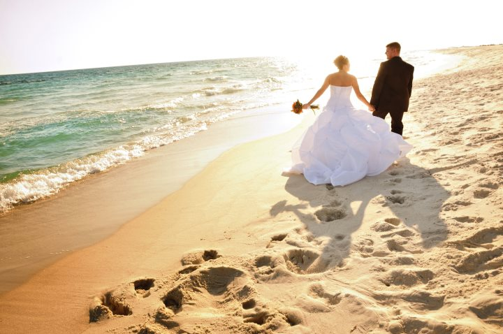 navarre beach wedding couple strolling